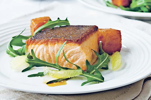 Salmon with confit lemon, caramel croutons and rocket